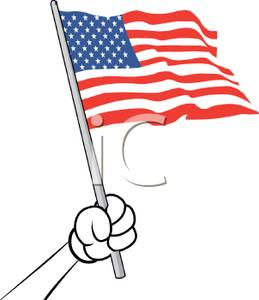 Hand Holding A Small American Flag   Royalty Free Clipart Picture