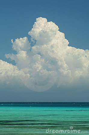 Cumulo Nimbus Cloud Towering Above The Tranquil Turquoise Waters Of