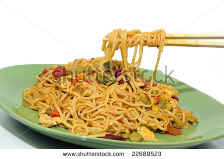 Eating Spicy Chinese Noodles With A Pair Of Chopsticks Stock Photo