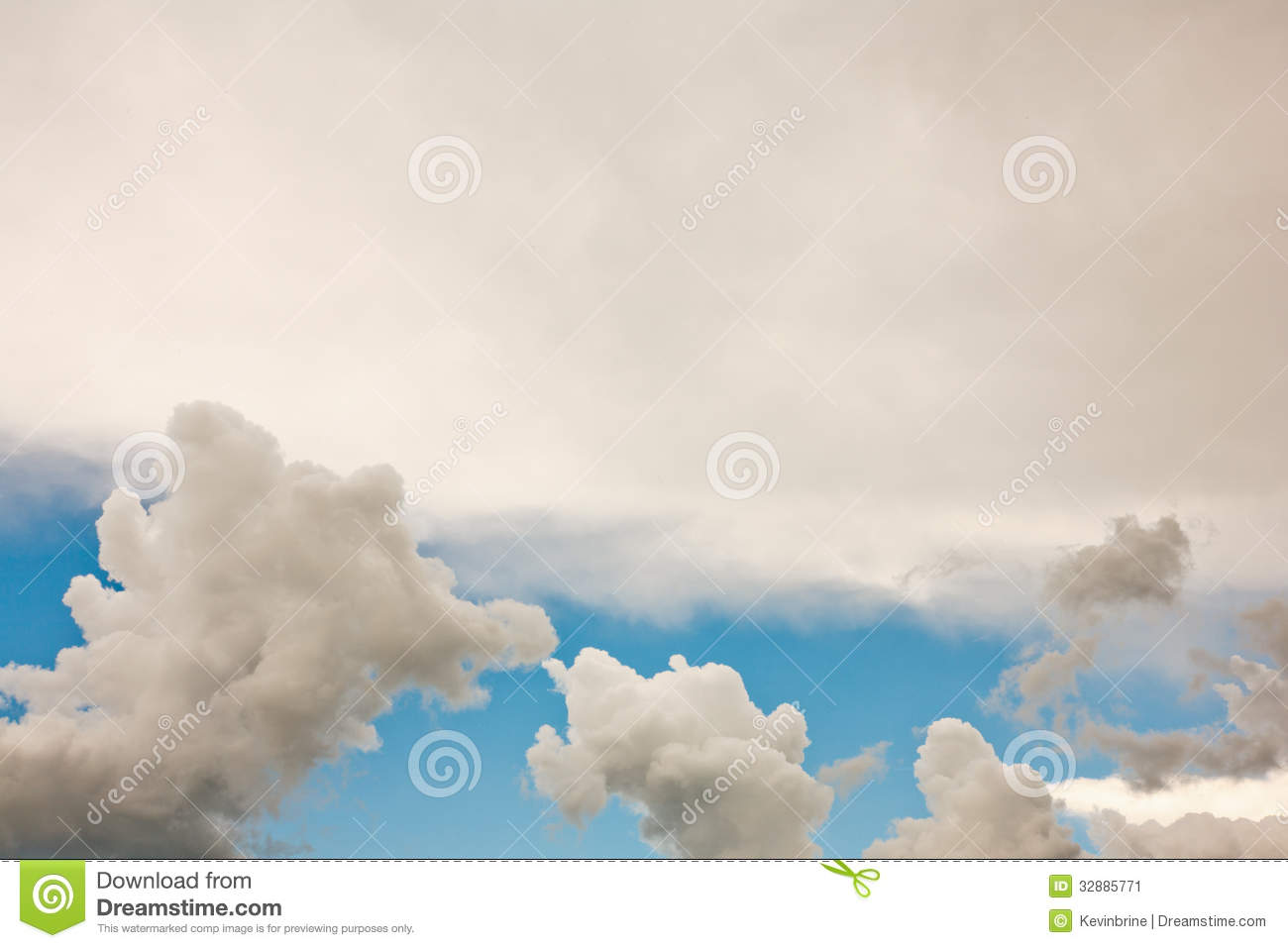 Cumulus Clouds And White Stratus Cloud With A Strip Of Blue Sky
