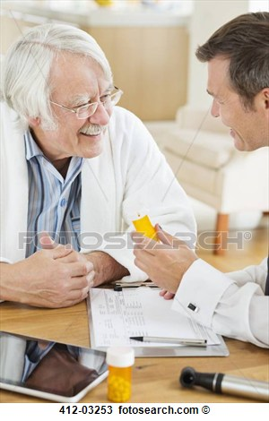Stock Photo Of Doctor Giving Medication To Older Patient At House Call