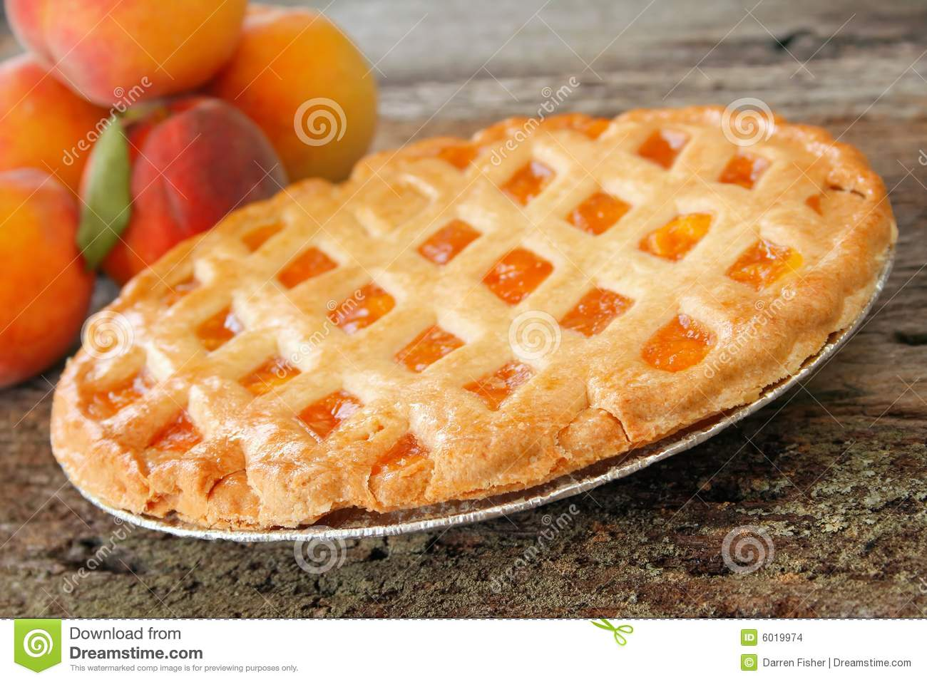 Fresh Baked Peach Pie With Fresh Peaches In The Background  Used A