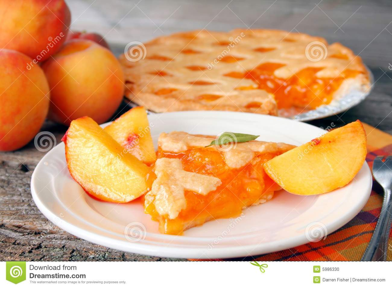 Slice Of Peach Pie With The Pie In The Background And Fresh