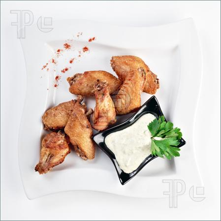 Fried Chicken Wings With Sauce Isolated On White By Clipping Path