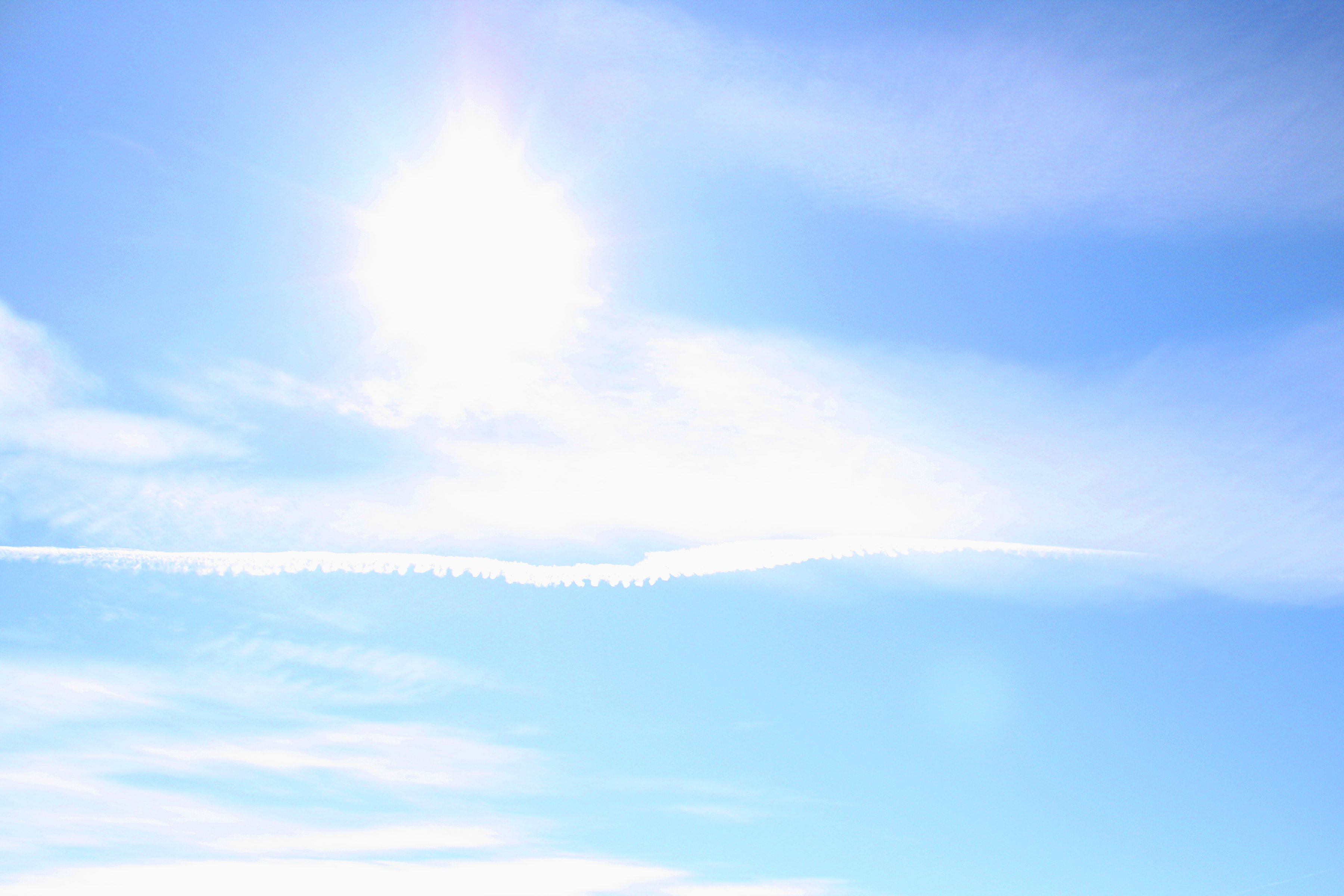 Blue Sky With Sun Clouds And Airplane Trail Picture   Free Photograph