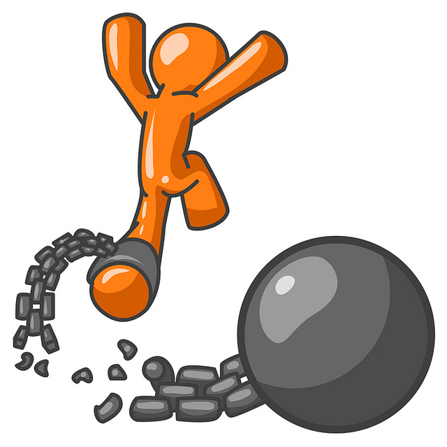 Orange Man Jumping For Joy While Breaking Away From A Ball And Chain