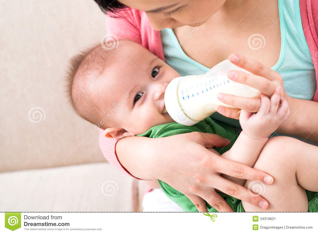 Mother Feeding Milk To Baby Clipart Illustrations Gg59413760