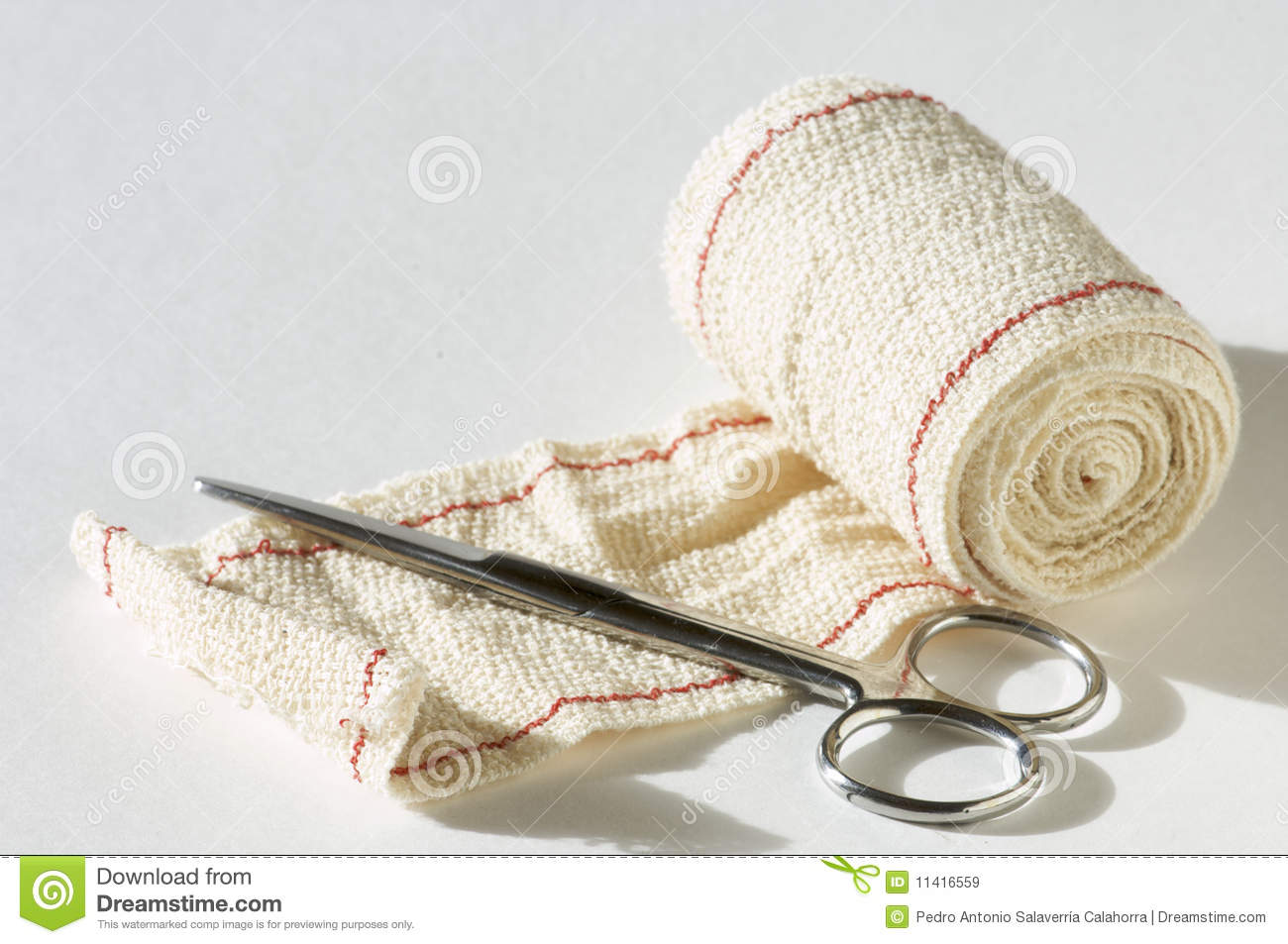 Medical Scissors And Bandages With White Background