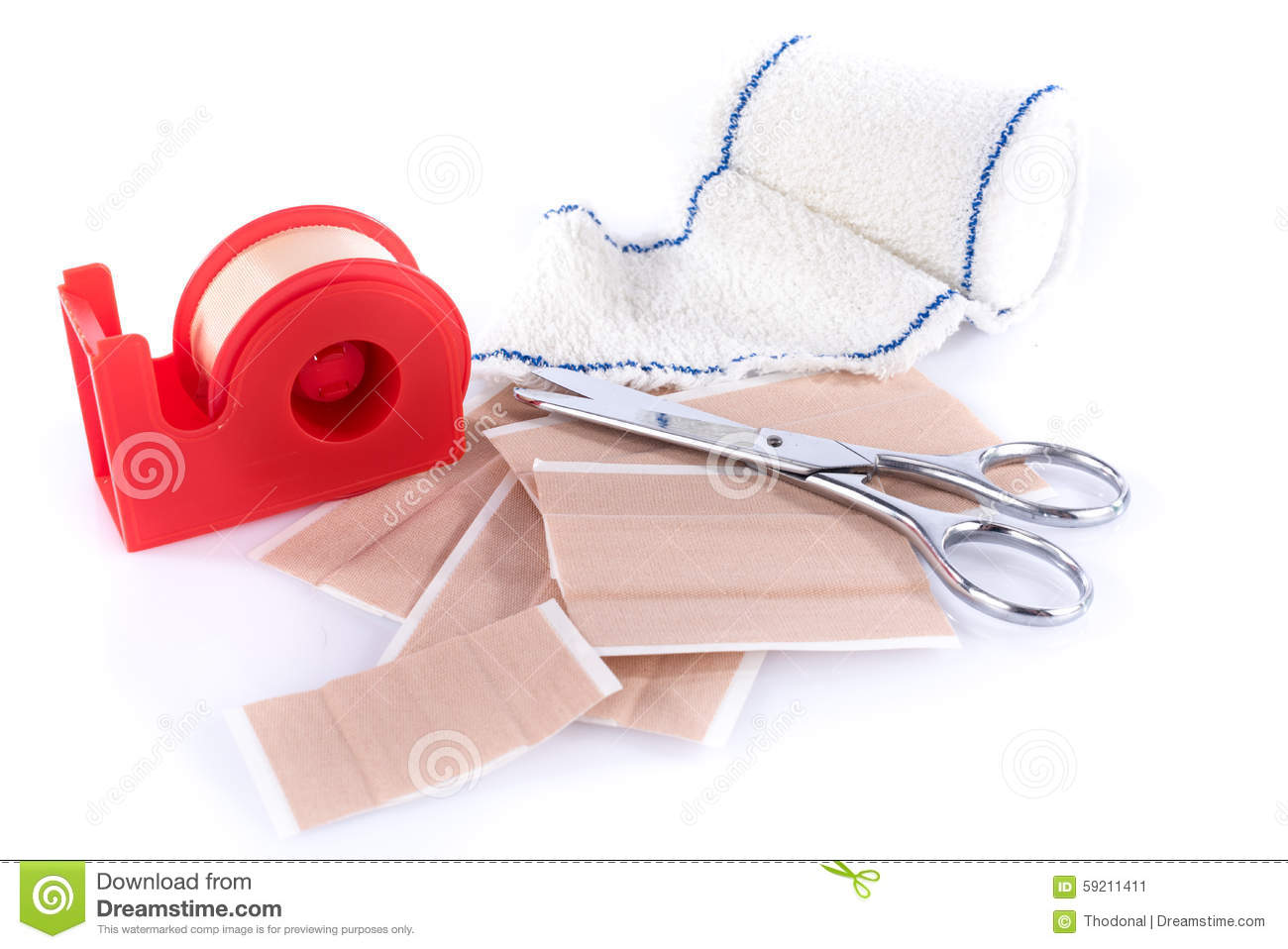 Plasters And Medical Bandage With Scissors Isolated On White