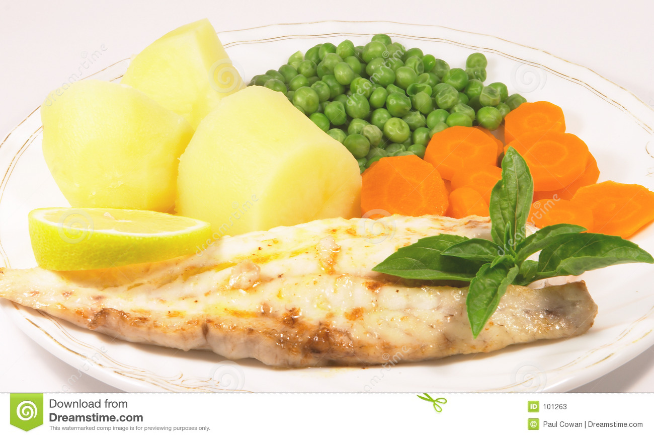 Meal Of Grilled Fish Fillet With Potatoes Peas And Carrots
