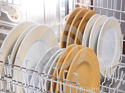 Open Dishwasher With Different Coloured Ans Sized Plates
