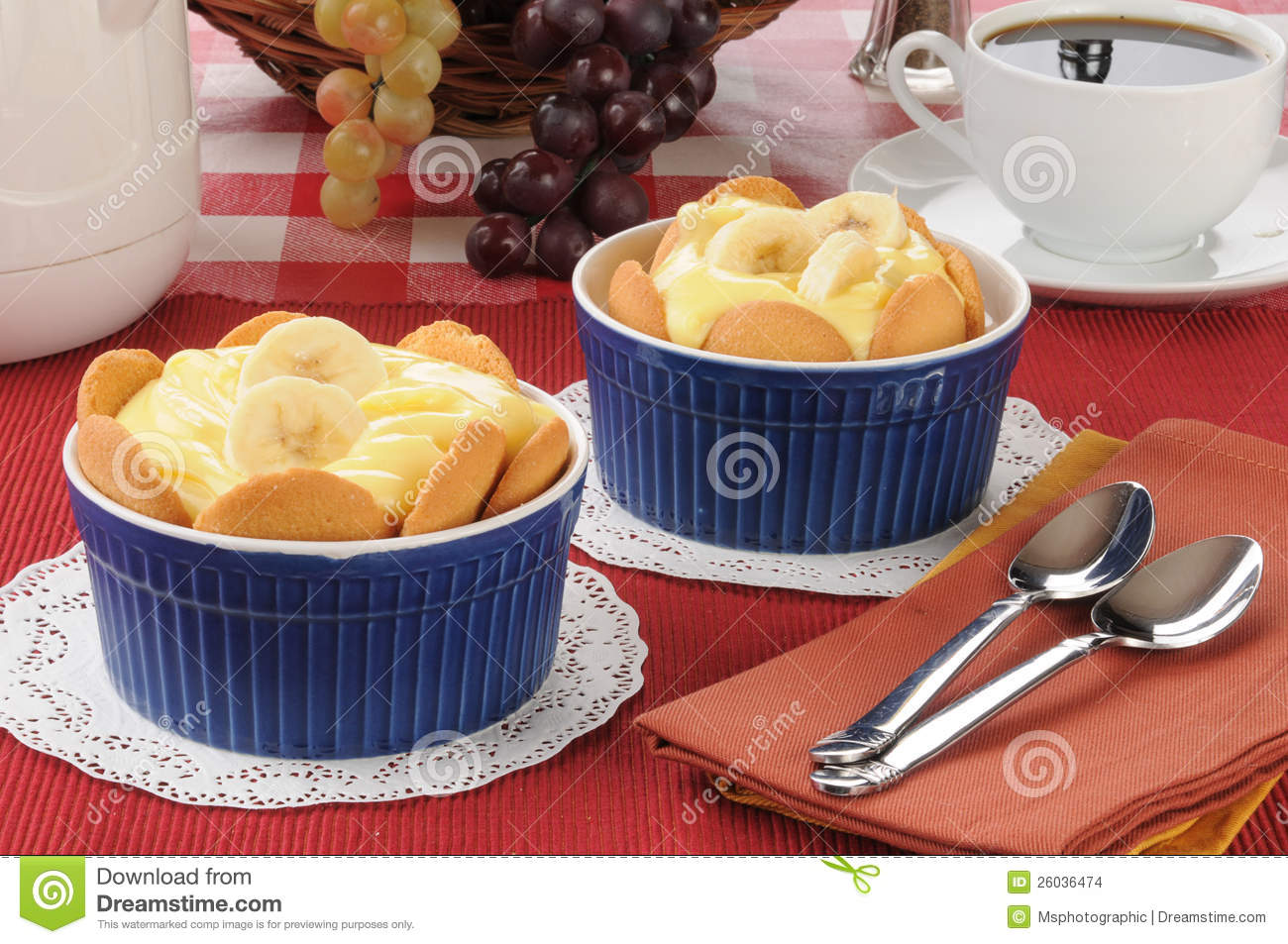 Two Cups Of Pudding With Vanilla Wafers And Banana Slices