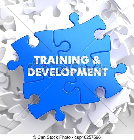 Training And Development Written On Blue Puzzle Pieces  Educational