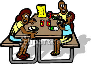 Family Having Lunch On A Picnic Table   Royalty Free Clipart Picture