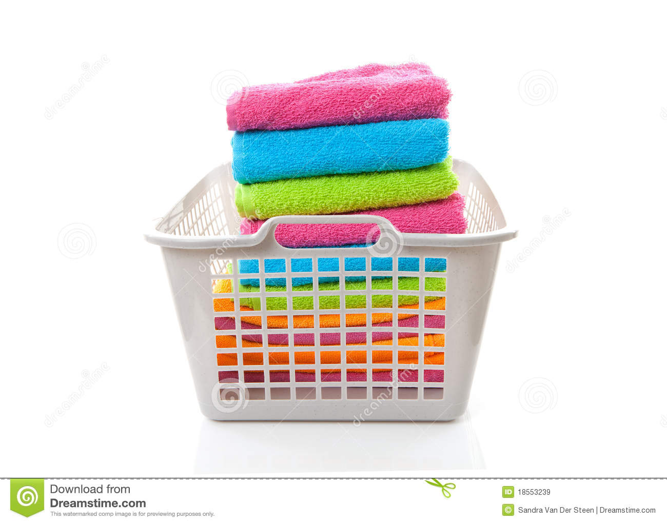 Laundry Basket Filled With Colorful Folded Towels Royalty Free Stock