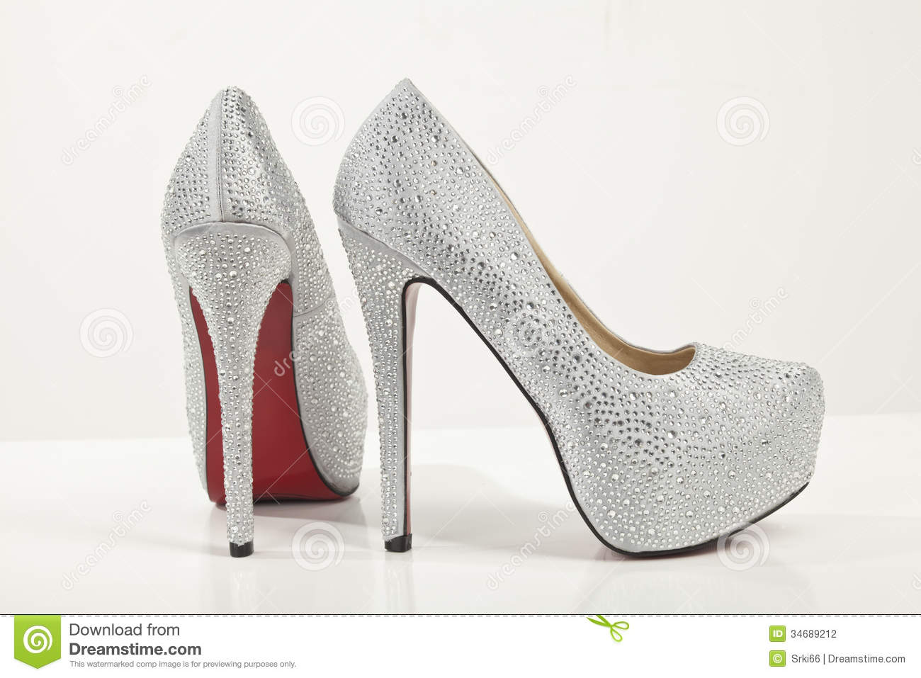 Silver High Heels Shoes On White Background