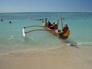 Beach Clipart Image  Outrigger Canoe Paddling Out Through The Surfers