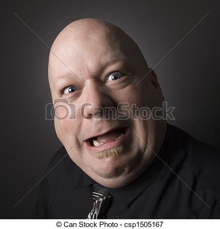 Picture Of Silly Face Man   Caucasian Mid Adult Bald Man Looking At