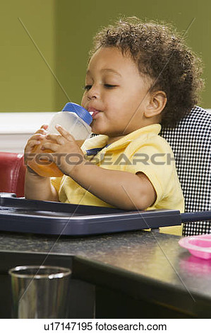 Stock Image   1 5 Year Old Mulatto Boy Drinking Juice   Fotosearch