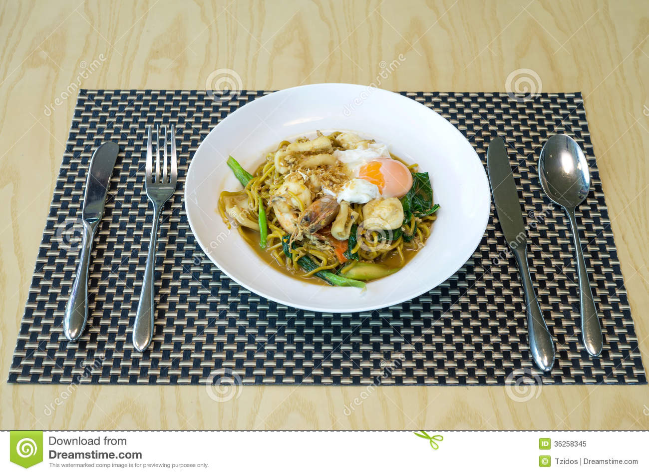 Fried Noodles With Sea Food Vegetables And Poached Egg Thai Food