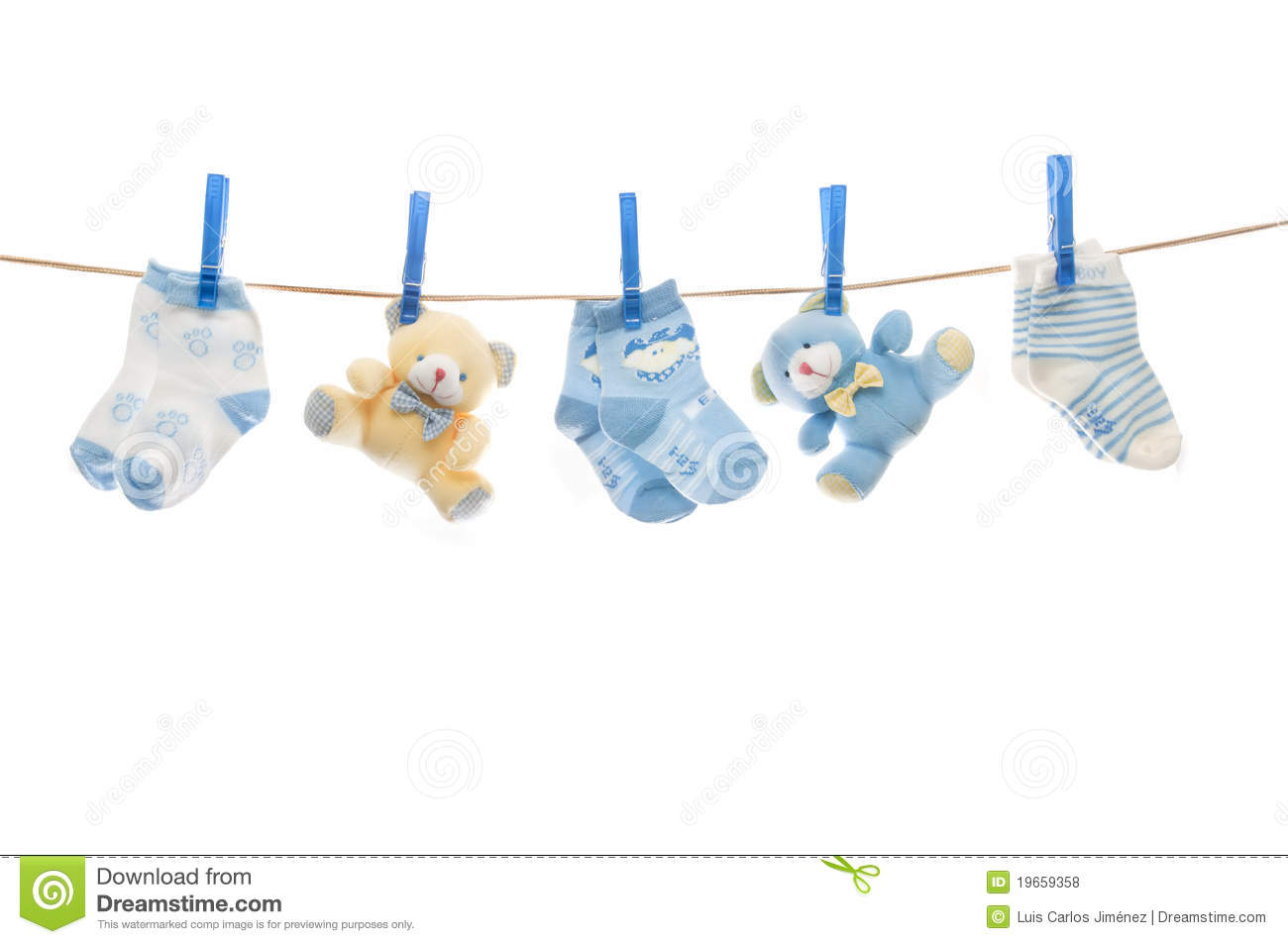 Teddy Bears And Baby Socks Lying On The Rope Isolated On White