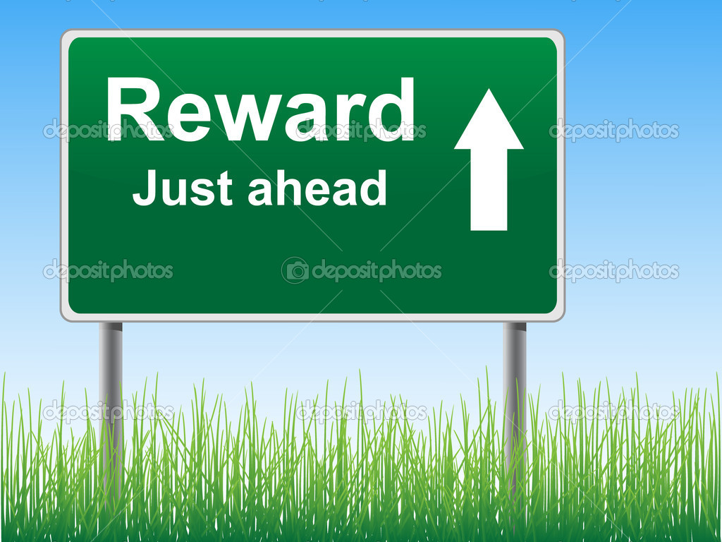 Reward Road Sign On The Sky Background Grass Underneath    Stock