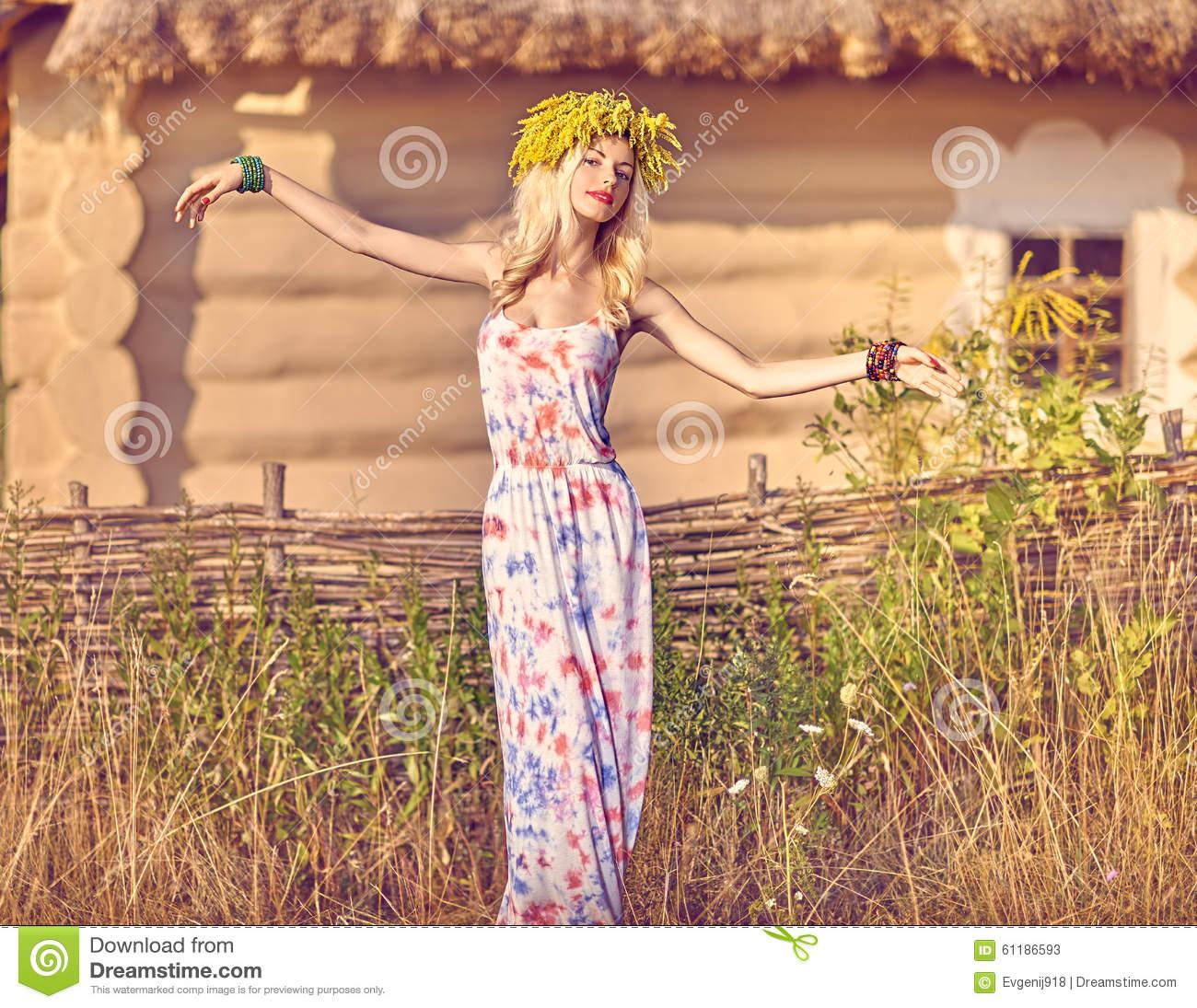 Boho Girl In Sundress Near Rustic House Summer Meadow Flowers  Field