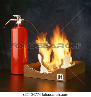 Stock Photo Of Fire Extinguisher Beside Office Tray Containing Burning