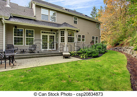 Stock Photo   House Exterior Spacious Backyard With Patio Area   Stock