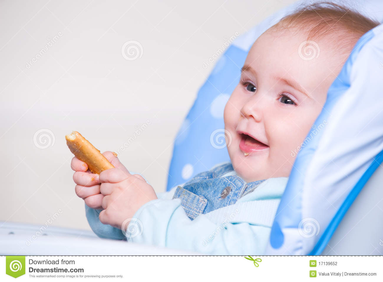 Happy Toddler Eating Cookie Stock Photography   Image  17139652