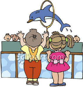 Watching A Dolphin Jump Through A Hoop   Royalty Free Clipart Picture