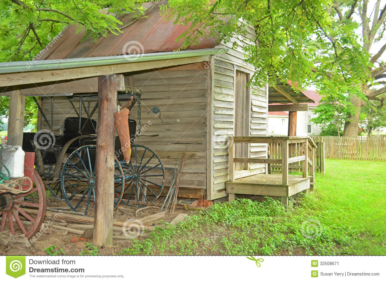 Small Old Wooden Shed With Shelter Covering A Antique Horse Carriage