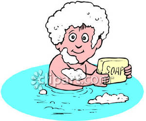 Holding A Bar Of Soap In The Bath Tub   Royalty Free Clipart Picture