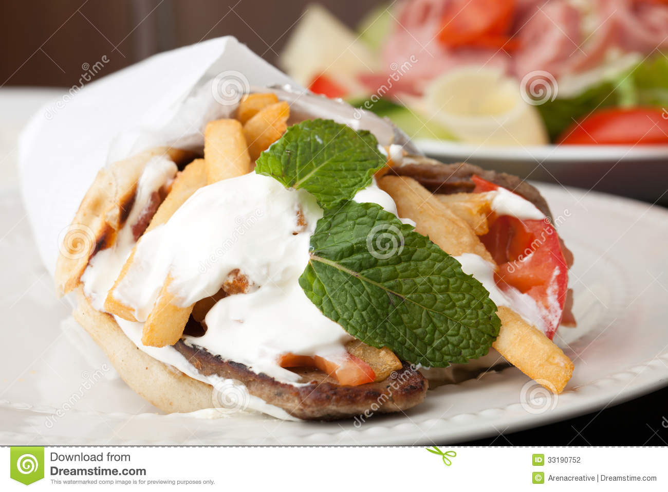 Traditional Gyro Sandwich With Meat Tzatziki Sauce Tomato Onions And