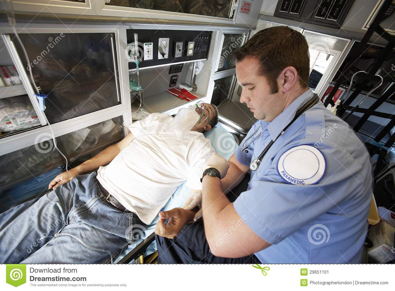 Emt Professional Taking Pulse Of A Man Stock Image   Image  29651101