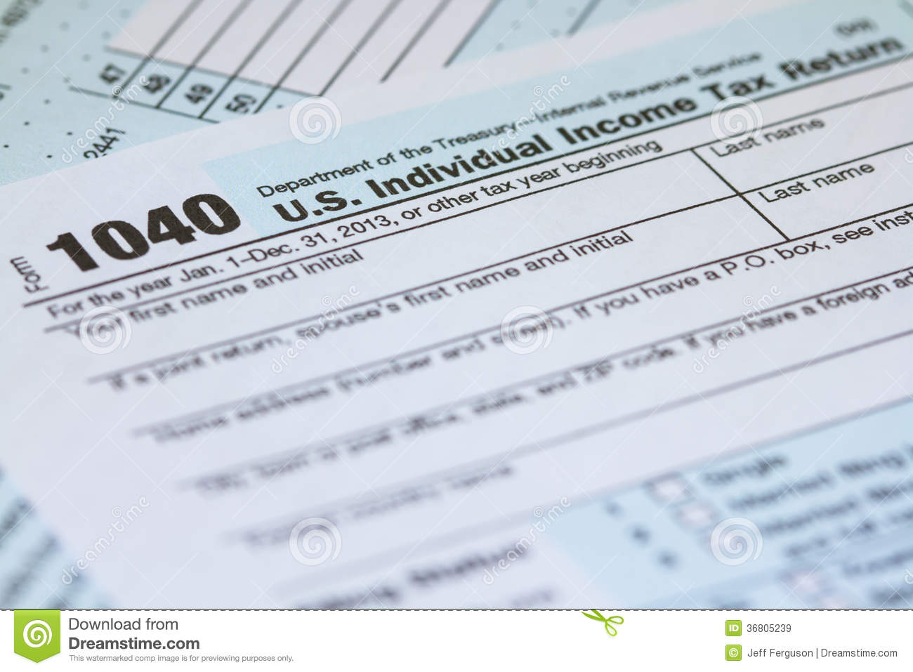 Photo Of A 2013 1040 Irs Tax Form Laying On Second Page Of Form