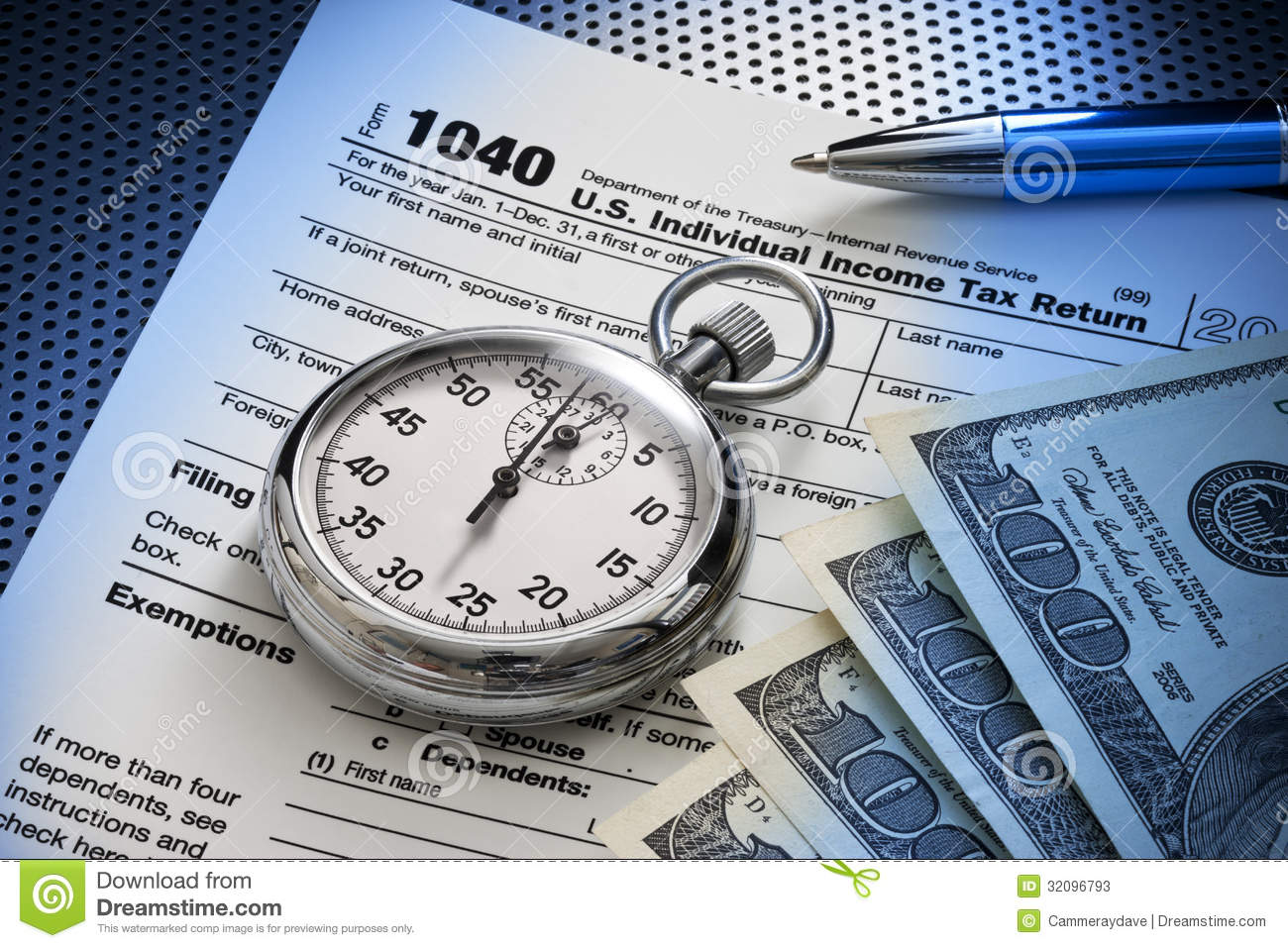 Still Life Of A Us 1040 Tax Form With Stopwatch Money And Pen