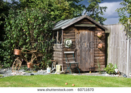 Back Garden Shed With Old Metal Bicycle   Stock Photo