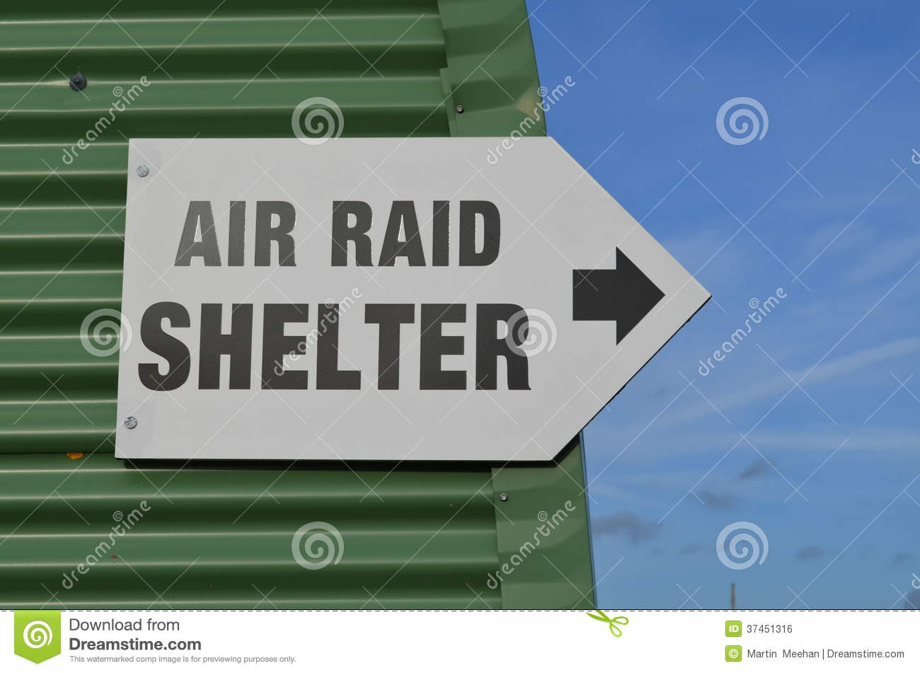 On A Metal Shed An Air Raid Shelter Sign Pointing To A Place Of Safety