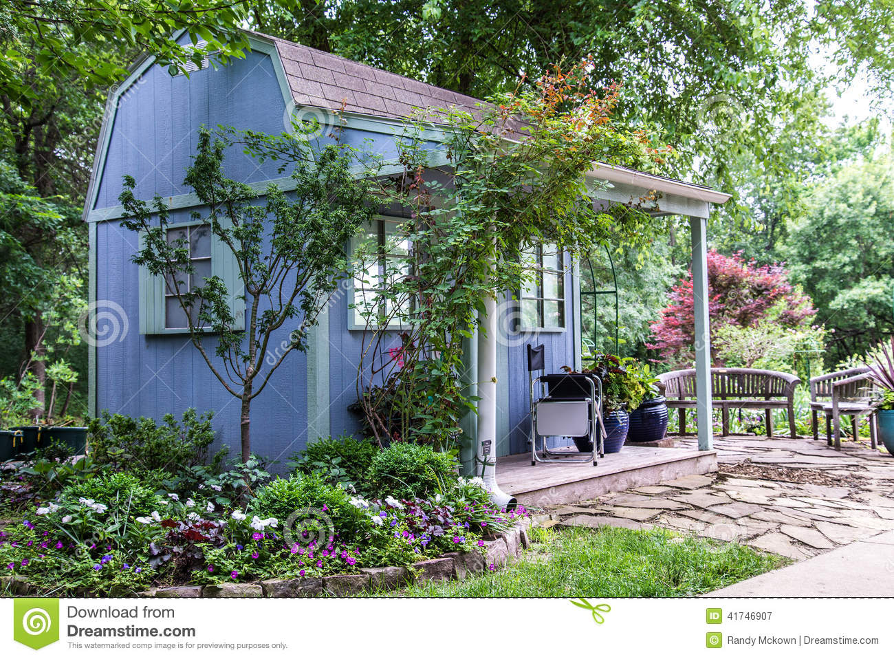 Small Building   Backyard Shed Surrounded By Beautiful Landscaping