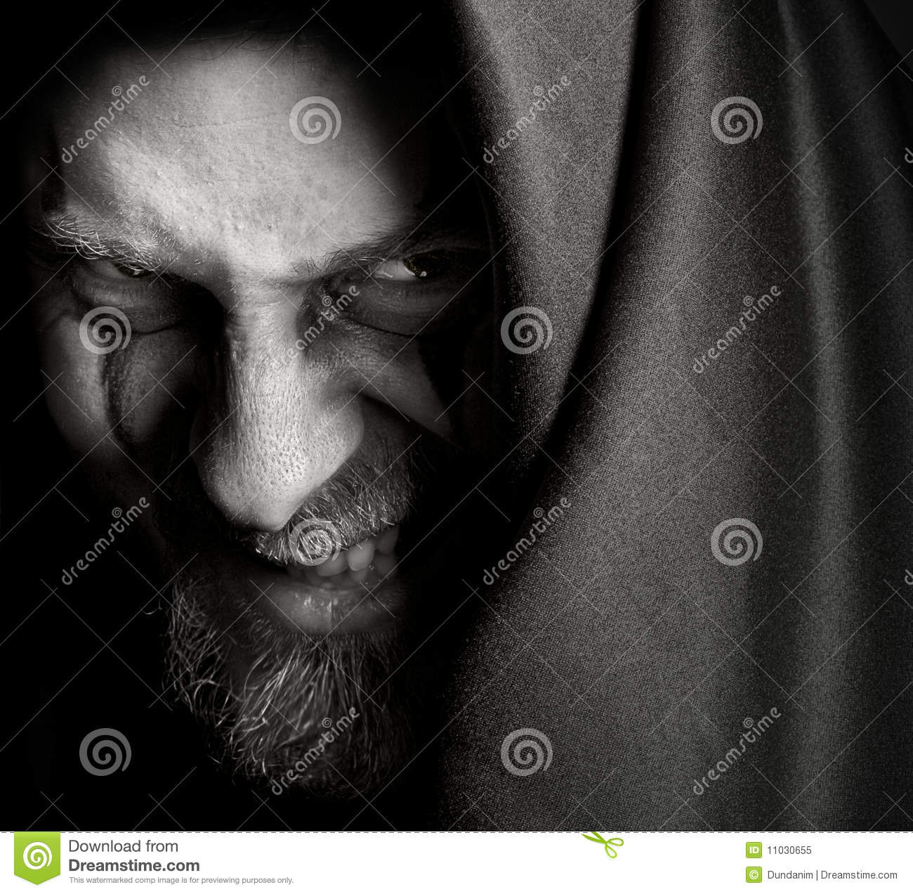 Evil Sinister Man With Malefic Wicked Grin Royalty Free Stock Photo