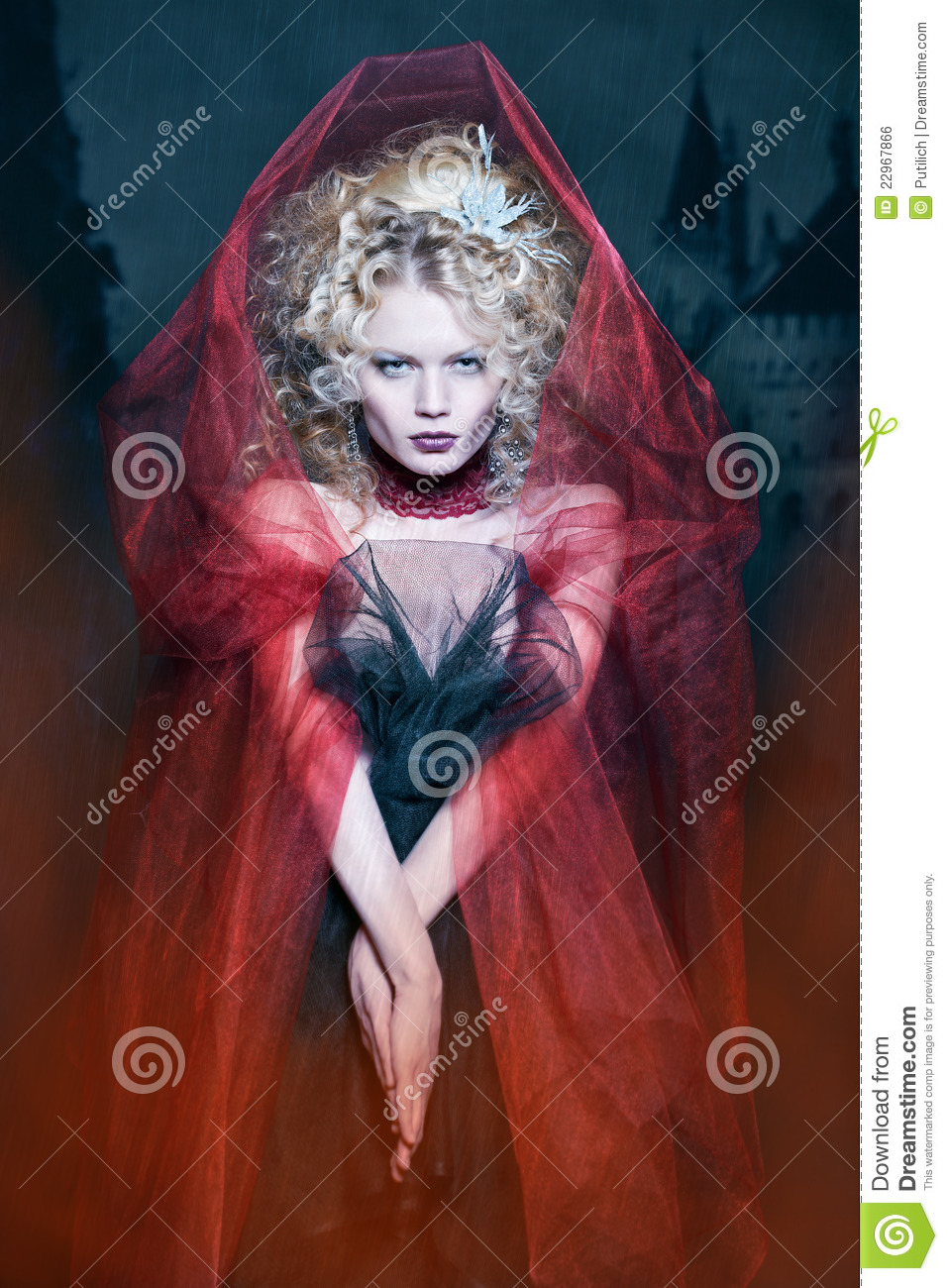 Glamorous Blonde Girl In A Maroon Cape With Stunned Hairdo  Fairy Tale