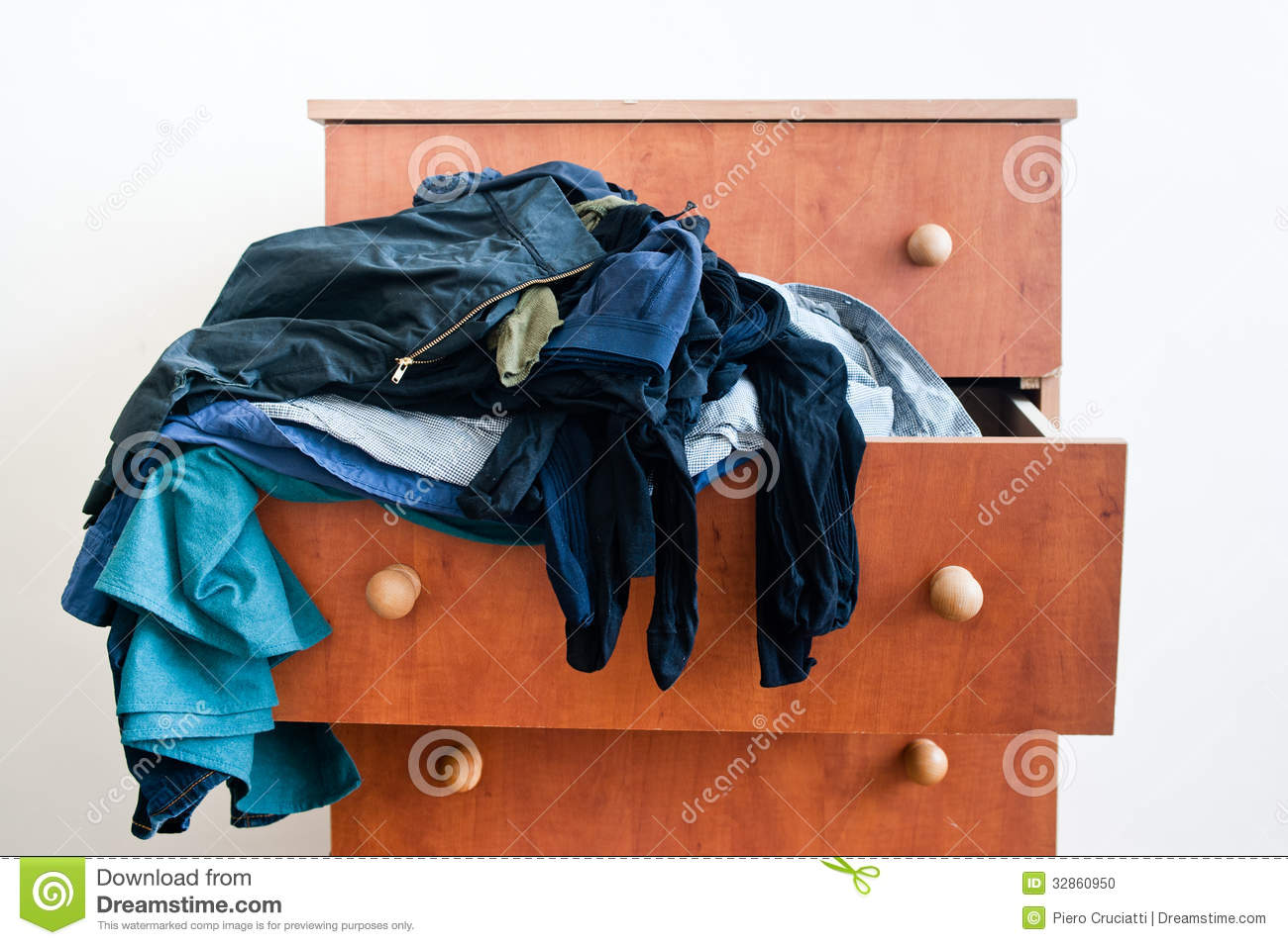 Messy Brown Chest Of Drawers With Mixed Man S And Woman S Clothes