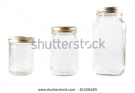 Three Different Sized Glass Mason Jars For Canning In Line On A White