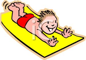 Haired Boy Sliding On A Slip And Slide   Royalty Free Clipart Picture