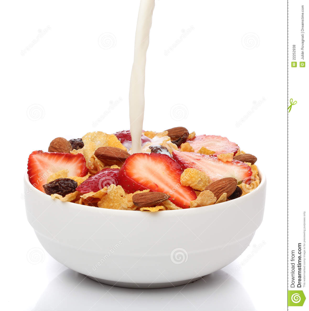 Pouring Milk Into A Bowl Of Cornflakes Royalty Free Stock Photos