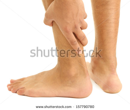 Young Man With Leg Pain Isolated On White   Stock Photo