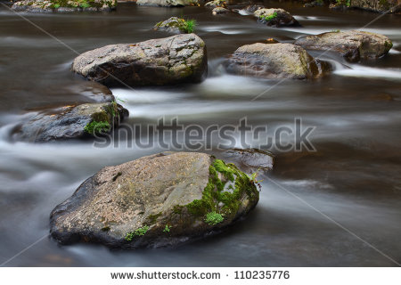 Streaming Water Between Big Rocks River Flow With Long Exposure Giving