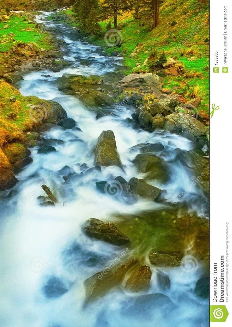 Water Rushes Down Over Rocks And Boulders In This Mountain Stream In