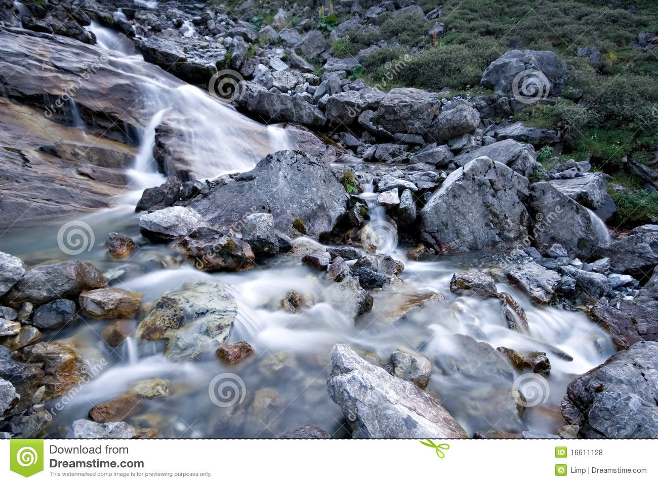 Water Stream Flowing Among Stones And Rocks  Royalty Free Stock Photos